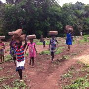 Students transporting bricks